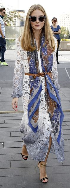 Olivia Palermo street style inspiration: A bright blue bohemian printed scarf belted over a lacy white maxi dress shows how Olivia always knows how to put a creative spin on classic pieces. Lace up heels and clear / lucite sunglasses make this lacey dress and scarf combination perfect for a Summer party.