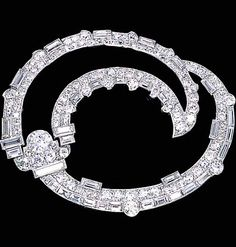 A DIAMOND BROOCH, BY CARTIER  Designed as an old European, single and baguette-cut diamond stylised double boteh, circa 1925 Signed by Cartier, London