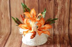 Butterfly flowers and Crotons for a cake! - Cake by Rumana Jaseel