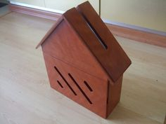 Wooden house letterbox.
