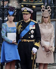 Prince Andrew with Beatrice and Eugenia...Beatrice, what were you thinking?! And Andrew, why didn't you tell your daughters that their hats were...well...hideous?