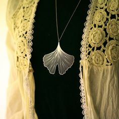 Ginkgo leaf design pendant. My favorite tree that symbolizes longevity and patience. Intricately done in stainless steel