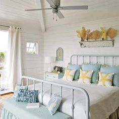 Feminine ruffles and fabrics play off a painted iron bed and rustic wall shelf. |  Photo: Richard Leo Johnson | thisoldhouse.com