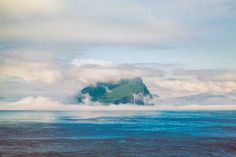 Clouds surround one of the Faroe Islands - Blurbomat.com