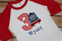 DIY your photo charms, compatible with Pandora bracelets. Make your gifts special. Make your life special! Personalized Thomas the Train Birthday Shirt by PerryWinklesEmb Thomas Birthday Parties, Thomas The Train Birthday Party, Trains Birthday Party, Train Party, Twin First Birthday, Friend Birthday, Baby Birthday, Birthday Shirts, Birthday Photos