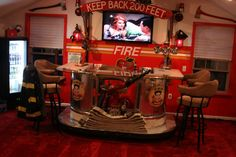 actually a man cave but some aspects would be cute for a fire themed play room (kids(