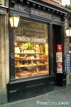 Bakery in Brussels, Belgium...Cool idea to have your window be a display of products available to outside and also behind the counter.