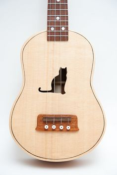 Celentano Woodworks ukulele. How cute is the kitty cutout?!