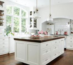 Modern Kitchen Cabinets - love the dark island top