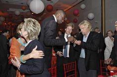 LR Senator Hillary Clinton hugs a friend as NBA star Dikembe Mutombo DeBeers Diamonds Managing Director Jonathan Oppenheimer and Virgin Records...