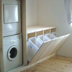 Ombouw voor wasmachine en droger + inbouw wasmanden.   Voorbeeld foto is een idee, er moet ook een deur voor de wasmachine/droger komen.  Tevens is er een staande diepvries die ook op deze wijze moet worden verbergt.