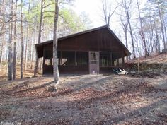 Off the grid get-a-way with 3/4 mi of National Forest boundary, a cabin with a screened in porch plus a patio over looking a mountain stream flowing over the rocks that fills a small pond. There is a barn to keep your ATV's under cover and with the abundant wildlife to make the fall hunting season a real pleasure in Mena AR