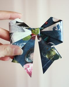 origami bow  original tutorial: http://helenmade.blogspot.com/2011/08/paper-bow-tutorial-and-break.html