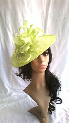 Pale Lime Fascinator.. Sinamay Shaped disc Fascinator with double swirls  1c61a38a0557