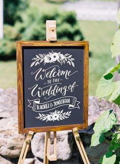 Wooden framed chalkboard wedding sign: http://www.stylemepretty.com/vermont-weddings/arlington-vermont/2016/10/21/were-calling-this-the-best-christmas-present-ever/ Photography: Nicole Baas - http://nicolebaasphotography.com/