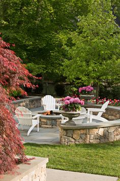 Patio - firepit, bluestone, curved granite wall - potted hydrangea - tulips | Cording Landscape Design