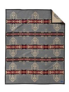 Love Pendleton Wool Blankets.  I crave Native American motifs and Pendleton does it so well.  Made in the USA.  Perfect on our bed.