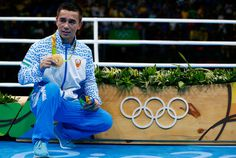 Gold medalist Hasanboy Dusmatov of Uzbekistan poses on the podium during the medal ceremony for the Men's Boxing Light Fly (46-49kg) Final on Day 9 of the Rio 2016 Olympic Games at Riocentro - Pavilion 6 on August 14, 2016 in Rio de Janeiro, Brazil.