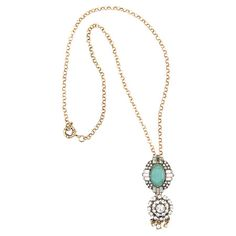 Perfect paired with crisp blouses or bright dresses, this eye-catching pendant showcases a teal faceted gem and rhinestone accents.