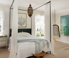 I love this bed but I would never hang a heavy, sharp-pointy lamp right above a bed ~ bad feng shui!