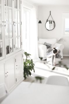 Love the Adnet mirror and white carpet