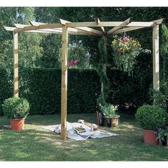 The Radial Pergola from Forest is a simple yet impressive structure that will complete your garden. Use it to train climbing plants along the horizontal beams, creating a unique spot of shade for you to relax and enjoy your garden in.<br/><br/>The pergola is manufactured from Pressure Treated timber to give it a 15 year guarantee against rot and fungal decay. To ensure stability and avoid being compromised by strong winds, the structure can be sunk into the ground.<br...