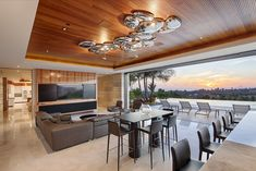 Outside Terrace with dining table under trellis and adjacent to vanishing edge pool.    Architecture and Interior Design by Matrix Design Studio.