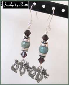 For each earring, I placed an 8mm Australian dragon's blood jasper bead between pewter bead caps and placed 6mm Swarovski XILION garnet bicones