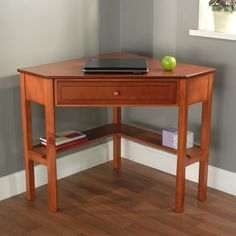 Wood Corner Computer Desk   Overstock.com, reviews say it's of poor quality but good value for what you get.