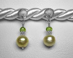 Golden South Sea Pearl and Peridot Earrings in Silver by JReneau on Etsy https://www.etsy.com/listing/243461197/golden-south-sea-pearl-and-peridot