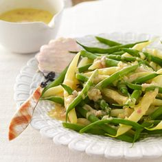 Punch up this side-dish recipe fast with the hardworking supermarket standby, orange juice concentrate.  Recipe: Green Beans with Orange Beurre Blanc   - CountryLiving.com
