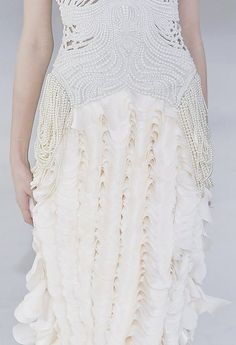 Pearl embellished dress detail with layered ruffle textures; couture fashion close up // Alexander McQueen