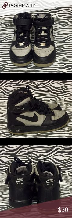Black/Silver Nike 6Y Air Force 1s. Black/Silver high Top with ankle strap and laces. Creased at toes, Lite signs of other wear on shoes. Bottoms in great condition. Nike Air Force 1s Shoes Sneakers
