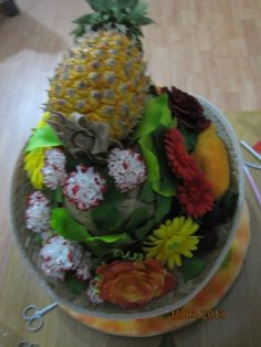fruit and flowers made from sugar for exhibition and display purposes custom made to order.  Food safe for cake decoration - edible art.  tania@cakearts.co.za