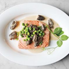 Poached Wild Salmon with Peas and Morels - This simple yet luxurious preparation is delicious with fresh wild king salmon, though you can use any of your favorite salmon varieties. Wild Salmon Recipe, Salmon Recipes, Fish Recipes, Seafood Recipes, Great Recipes, Cooking Recipes, Favorite Recipes, Healthy Recipes, Delicious Recipes