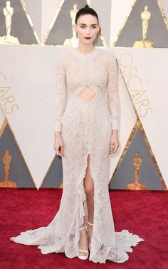 WHO: Rooney Mara wears a white lace Givenchy gown with white sandals.