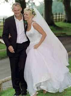 Love the simplicity of Zoe Ball's wedding dress and the hair adorned with flowers.