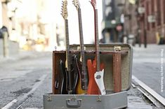 (New Uses for old Suitcases) This guitar stand from the master Macgyver-ers at Readymade keeps things corralled, and folded up is easy to tote on stage or to band practice.