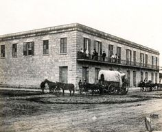 """The Vance House on Houston Street in San Antonio. This site is now occupied by the Gunter Hotel. Mules, Horses and Wagons in San Antonio. By Hugh Hemphill, author of """"San Antonio On Wheels"""" and """"The Railroads of San Antonio and South Central Texas."""" Courtesy: The Texas Transportation Museum, San Antonio, Texas (USA)"""