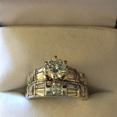 14kt White Gold Wedding Ring Gia certified wedding ring appraised for $7,172. Round Brilliant Diamond .75 ct. 6-prong set. Size 4. See GIA paper in images for complete details. Devons Jewelry Jewelry Rings