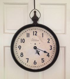 """Reclaimed vintage Telechron clock face, outfitted with hand-welded steel frame and old farm hardware by designer Stephanie Reppas.  Derived from the Greek words tele, meaning """"far off,"""" and chronos, """"time,"""" Telechron was US company that manufactured electric clocks between 1912 and 1992. Founder Henry Ellis Warren introduced the synchronous electric clock. Telechron had its heyday between 1925 and 1955."""