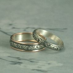 Our two tone Going Baroque wedding band set is a lovely compliment to a garden style wedding. With this listing you can pair our brand new Touch of Gold Going Baroque Band with its matching sterling silver mate.  The all silver band is hand forged from 3.5mm silver preformed pattern wire that has been imprinted with a swirl and leaf design. Its two tone partner is made from this same material with just a touch of gold added to either end. We expertly add a 1mm in diameter strip of full round…
