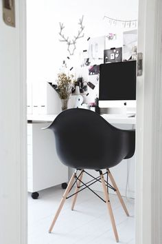 Black Eames style tub chair