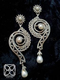 A unique & dazzling pair of chandeliers in white pearl & cubic zarconia!In 925 silver with rhodium plating!                                                                       https://www.facebook.com/pages/Damiya-Jewellers/289361234463272?ref=hl