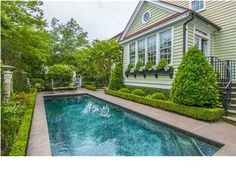 The world's most perfectly manicured pool, running along the span of the back yard. An aquamarine gem.