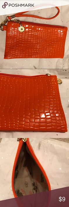 Orange makeup bag Got it as a gift, never worn. In great condition. Listed under Victoria secret for exposure. Victoria's Secret Bags Cosmetic Bags & Cases