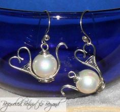 White Pearl Wire Sculpted Teapot Earrings by BBBjewelsUnique, $18.00. These are so cute!