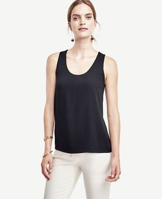 "An indispensable spring-to-summer piece, this style anchor tops off the season in coveted colors and a breezy knit and woven mix. Scoop neck. Sleeveless. Woven front. Knit back. 25 1/2"" front length; 25"" back length."
