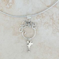 Sterling Silver Autism Awareness Loves Embrace Pendant on Black Cord Necklace | eBay