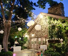Under the night sky, twinkling string lights and paper lanterns create an enchanted feel for this charming garden wedding.